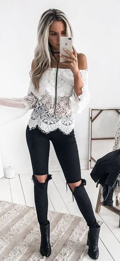 Pretty white lace blouse with distressed black denim jeans.