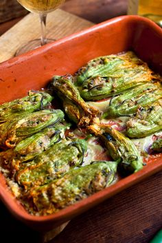 Sabine's Stuffed Zucchini Flowers // aka bread pudding in the best vehicle to contain it, a zucchini flower! (can also stuff into tomato -- that also sounds fresh! Zucchini Flowers, Zucchini Blossoms, Stuffed Tomatoes, Stuffed Peppers, Zucchini Bread, Stuffed Zucchini, Milk And More, Stale Bread, Flower Food