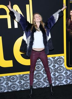 Behati Prinsloo keeping herself on trend with a furry topper and wedge boots for the screening of 'American Hustle' in New York on December 8, 2013