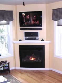 Check out how these homeowners dressed up an unused corner with a cozy ventless fireplace and TV. |  thisoldhouse.com