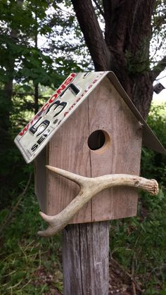 Rustic wren birdhouse with Wisconsin license plate roof and deer antler perch by RusticCabinManCave on Etsy