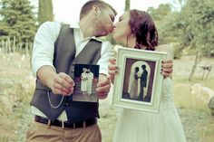 Bride and groom with pictures of their parents on their wedding days.