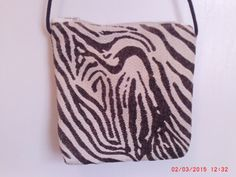 Handmade Zebra Sling Carpet Bag in Brown and Off White by Pandente