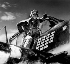 """Lt.(jg) Alexander Vraciu in his F6F after the """"Mission Beyond Darkness"""" Battle of the Philippine Sea June 20 1944. He was a United States Navy fighter ace a Navy Cross recipient and a Medal of Honor nominee."""