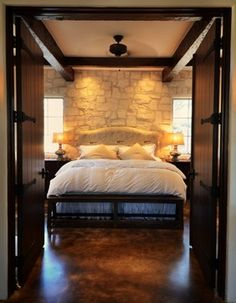 Master Suite - Texas Hill Country style - acid-stained concrete floor, Austin stone wall...love stained concrete...love everything about this bedroom!!! Will definitely have these floors when we build...carpet is just a dust/dirt collector and I don't care for it!!!