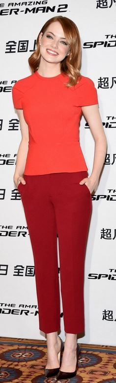 Emma Stone: Shirt and pants – Roland Mouret  Shoes – Christian Louboutin  Earrings – EF Collection  Ring – Red C Jewels