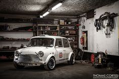 Perfect photo! One of those beautiful tuned Minis and it's working class environment.