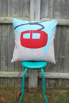 This pillow design was inspired by a vintage ski poster with bright pops of color and graphic appeal. Warm and cozy wool blend felt is the