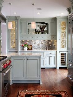 #Kitchen Inspiration! #Metallic tile backsplashes are a wonderful way to provide a textural contrast to kitchen cabinetry that has been painted in a matte or semi-gloss paint finish. Kitchens. Backsplash Designs. Tile Design. Hadley Court Interior Design.