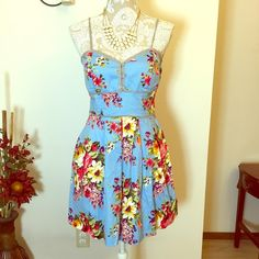 Floral dress Cute blue floral dress, very colorful! It has adjustable spaghetti straps and it ties in the back. The bra is lightly padded. 27 inches long and waist measures 14 inches laid flat. Perfect condition! Alyn Paige Dresses