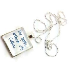 An amazing inspiring sterling silver glass pendant with the words 'Be happy.others will follow.' Each pendant has a glass dome top, that magnifies the design beautifully.