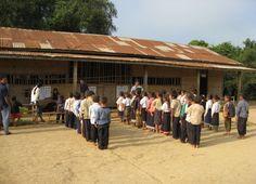 Laotian school children standing to attention