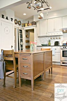 kitchen island made by placing two old school desks back to back.  Not only is it a good place for kitchen prep, it is a good place to sit and write letters the old fashioned way, file the bills, research recipes...  LOVE!