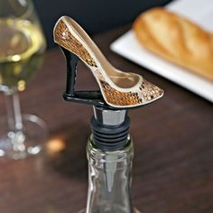 Top off your wine bottles with a little sass! With our Leopard High Heel wine bottle stopper, you can bring a little high fashion to your wine decor. Featuring a leopard print high heel atop a stainless steel stem with rubber gaskets, this bottle stopper ensures a tight seal on your favorite wines. Measuring 4.5  long  from the top of the shoe to the base of the stem, this wine bottle stopper fits most standard-sized bottles of wine.