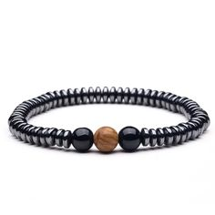 et go of painful patterns and discover the art of healing.  Constructed to cast forth a grounding energy, this men's bracelet has a way of purging the spirit of negativity. Hematite beads induce calmness in times of stress, while the wooden bead reminds you to always remain figuratively in proximity to nature.  FREE Shipping Worldwide.