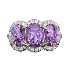 Purple Sapphire and Diamond Ring | From a unique collection of vintage three-stone rings at http://www.1stdibs.com/jewelry/rings/three-stone-rings/