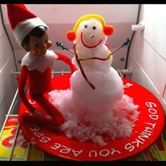a few different funny elf on a shelf ideas... Pictured here: elf making a snowman in the freezer. just shred some ice cubes on a cheese grater! KEEVVVIINNN!!