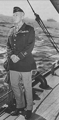 Maj. Gen. George S. Patton, Jr., aboard the USS Augusta, the Western Task Force headquarters ship. Part of the 'Torch' convoy is barely visible in the background.