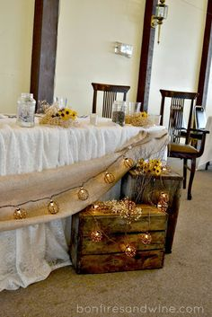 rustic head table decor--draped taupe fabric or burlap, strand of white twinkle lights with grapevine ball cages, decorative wooden boxes at the sides of table with rustic flowers (sunflowers, viking daisies, etc) Head Table Wedding Decorations, Head Table Decor, Wedding Table, Wedding Burlap, Wedding Rustic, Reception Table, Dinner Table, Wedding Bells, Wedding Centerpieces