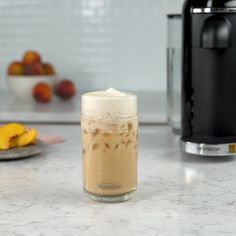 Iced coffee season just got peachy. Introducing our newest summer concoction. - 1 oz. peach syrup - 1 tsp. honey - 2 espressos - Ice - 4-6 oz. milk - Shake