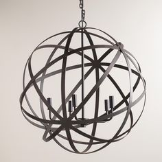 Crafted by Indian artisans in a unique industrial style, our exclusive five-bulb chandelier features an open, geometric design finished in aged black. This large, globe-like chandelier has a timeless appeal that's perfect for any room in the home.