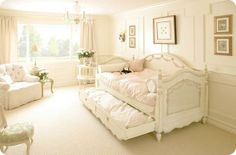 I absolutely adore this bedroom dressed in pink and white. I'm a big fan of daybeds and this one is beautiful.