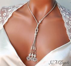 Fine Silver Woven Wire Love Knot Necklace With Long Tassel by NMBeadsJewelry