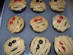 Pipe frosting over  M&M's eyes for mummy cookies or cupcakes