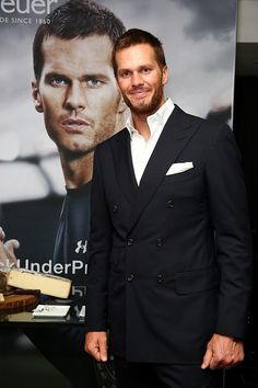 @tagheuer representative Tom Brady in front of TAG Heuer ad. For full story, visit: http://www.watchtime.com/wristwatch-industry-news/scene/tom-brady-joins-tag-heuer-as-brand-ambassador-at-carrera-heuer-01-launch/ #tagheuer #watchtime