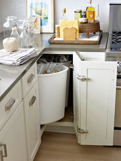 Use a Lazy Susan system for your kitchen garbage and recycling.