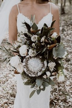 Inspiration and ideas for wedding and bridal flowers. White Australian native bouquet with protea, roses and greenery. Proteas are a great flower to include in your bridal bouquet and centerpieces. Simple Wedding Bouquets, Protea Wedding, Rose Wedding Bouquet, Bride Bouquets, Bridal Flowers, Floral Wedding, Purple Wedding, Non Flower Bouquets, Boquette Flowers