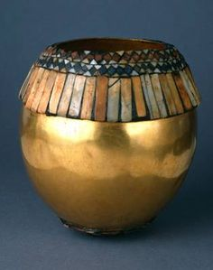 Vessel in the shape of an ostrich egg (Height: 4.6 cm; Diameter: 13 cm) of gold, lapis lazuli, red limestone, shell, and bitumen, hammered from a single sheet of gold and with geometric mosaics at the top and bottom of the egg. The dazzling array of materials came from trade with neighbors in Afghanistan, Iran, Anatolia, and perhaps Egypt and Nubia. From the Royal Cemetery of Ur, ca 2550 BCE.