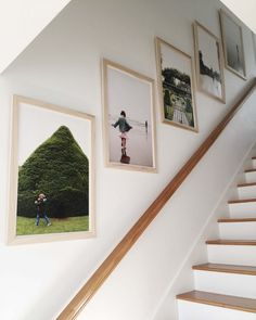 16 Best Staircase Wall Decor Ideas to Make Your Hallway Look Amazing Stairways are one of the greatest spots in a home to hang the art. For many homeowners, the ability to beautify the curved staircase wall decor can be exciting! Staircase Frames, Staircase Pictures, Gallery Wall Staircase, Stairwell Wall, Gallery Wall Frames, Curved Staircase, Staircase Design, Frames On Wall, Picture Wall Staircase