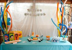 Bubble Guppies party. I like how the balloons look like seaweed!