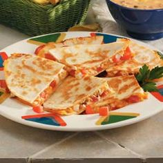 Quick Chicken Quesadillas:  Cut chicken into small pieces using kitchen shears and place in greased skillet. Pour 1 can of Mexican(Lime & Cilantro) Rotel over chicken and cook until all the liquid is gone.  Fry inside a flour tortilla or wrap up as a burrito.  Extra ingredients we like include Uncle Ben's Spanish Rice and Mexican Dipping Cheese(jalapeno flavored).