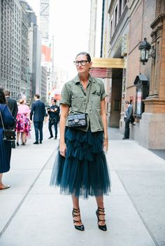 "Jenna Lyons, the J. Crew creative director, dressed with practiced nonchalance in a well-worn olive-drab field jacket and a multilayered tulle Dries Van Noten skirt. ""The first time he notices you,"" Ms. Lyons said of Mr. Cunningham, ""you remember as clear as day."""