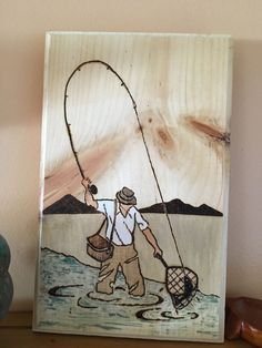 Wood burn fisherman with paint and stain.  #woodburning #pyrography #stain…