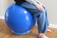No need to buy one of those expensive ball office chairs.  Turn an exercise ball into a chair using $1 pool noodle