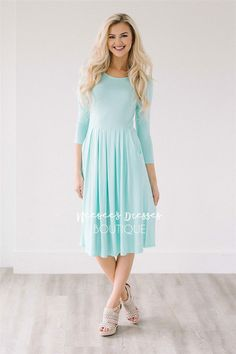This cute spring dress is light weight, the perfect length and perfect for spring and summer. Mint dress features 3/4 length sleeves, a pleated waist and adorable front pockets.