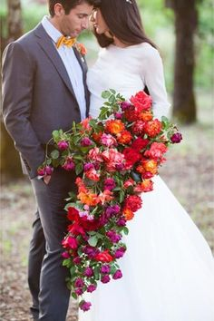 Featured Photographer: Larissa Cleveland; Romantic orange, pink, red and purple wedding bouquet that's perfect for the fall season; Featured Photographer: Larissa Cleveland