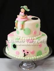 2 tier round pink and green polka dot baby shower cake