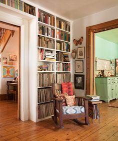 Built-in bookshelves, high ceilings, hardwood floors. (Look at that mint green room!)