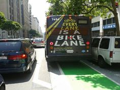 Here's a bus blocking a bike lane in the most ironic way possible