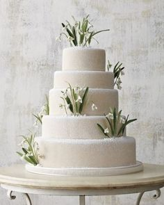 snowdrops on this simple white tiered cake