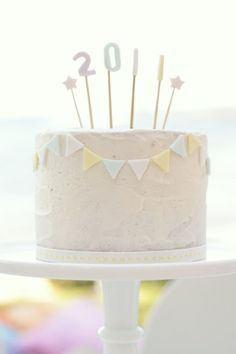 Cake by Hello Naomi.                                Gorgeous, simple icing but love the bunting!