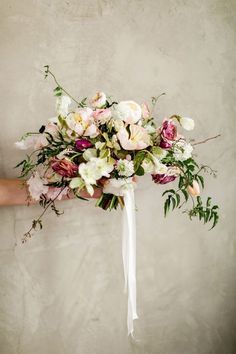 Whimsical Peach and Purple Bouquet with Botanical Flowers | Rustic White Photography | http://heyweddinglady.com/enchanting-wedding-flowers-peach-plum-gray/