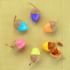 Leftover Easter eggs are just what your fall party needs. Use hot glue to attach twine to the wider end of the egg, and leave a tail for an acorn stem. Fill them with goodies to send your guests off in good spirits./