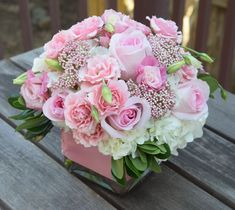 Sweet pink flower arrangement with spray rose, roses, hydrangeas, lisianthus and rice flower.