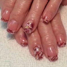 Red, white, and gold marbled acrylic nails