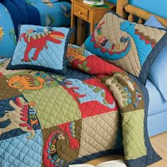 Ethan went nuts when he saw this! Got to make it happen! Dinosaur quilt bedding